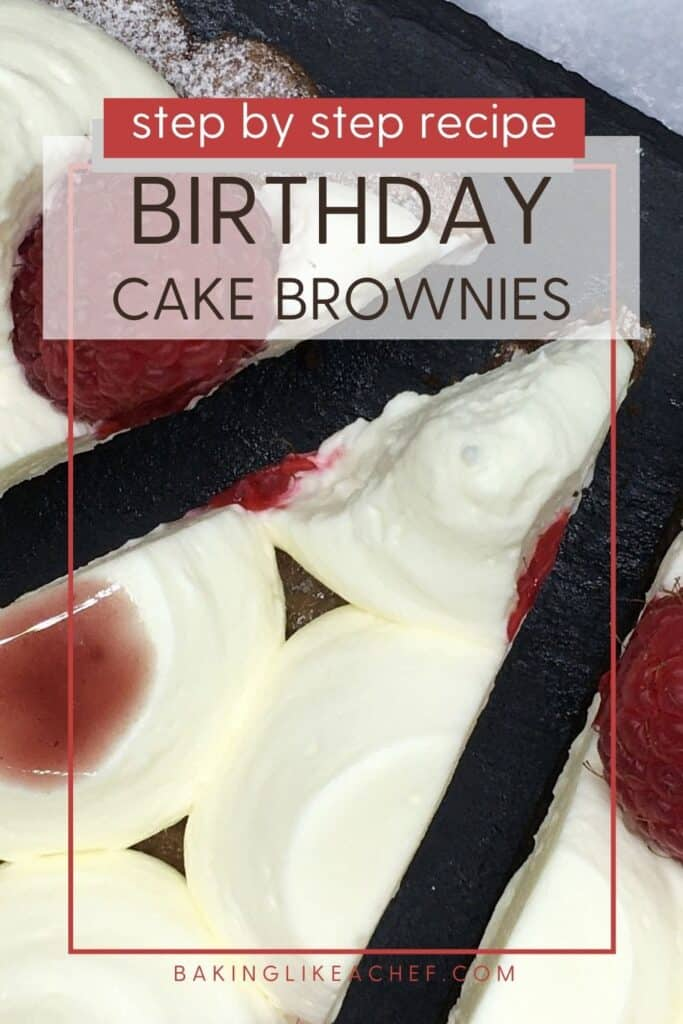 Sliced birthday brownies topped with cream and red fruit on a black platter: Pin with text