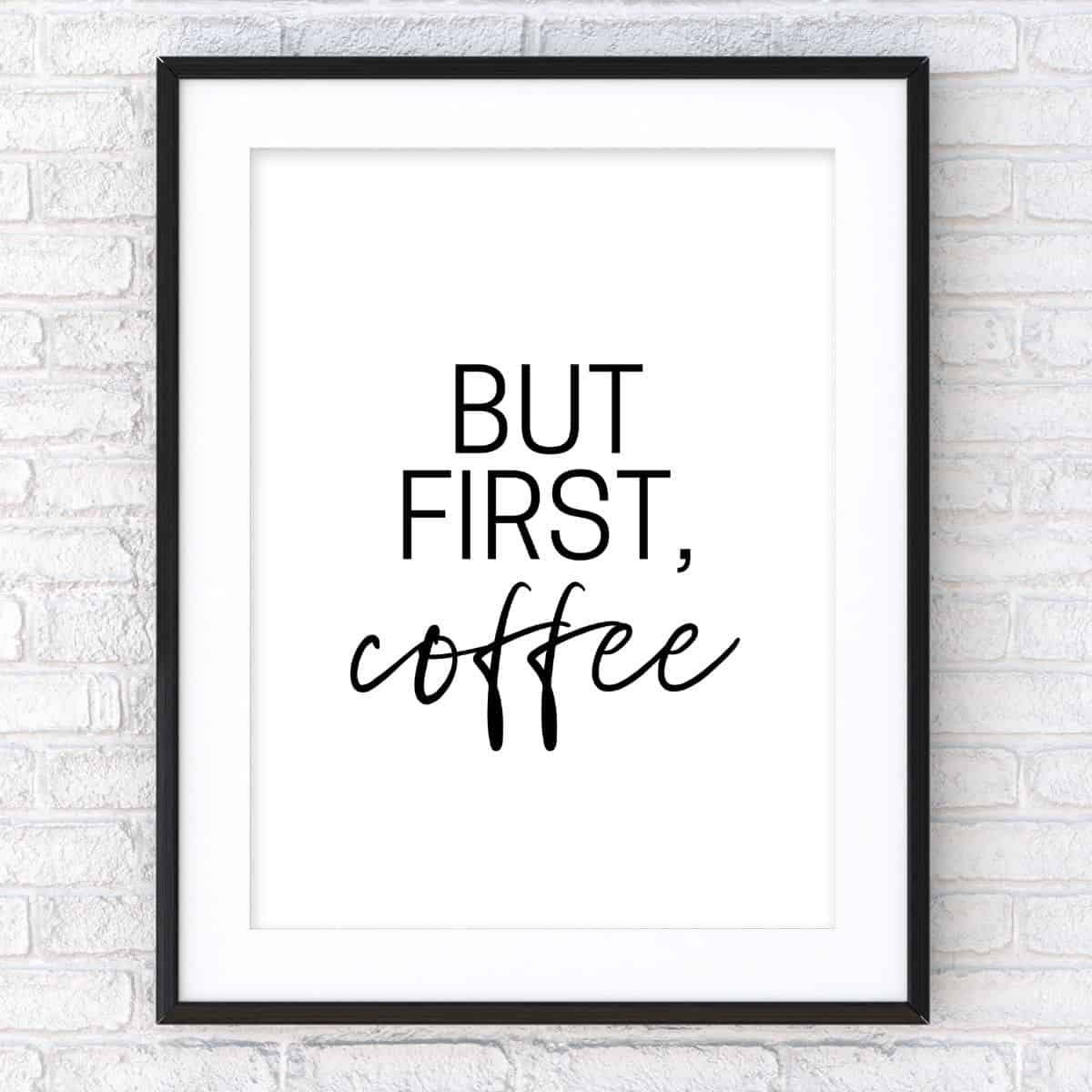 Black frame on the brick wall with the text: But first, coffee