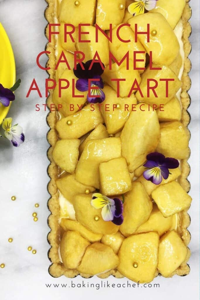 French apple tart garnished with apples in a tart pan with a yellow cup and glod pearls on the background: Pin with text