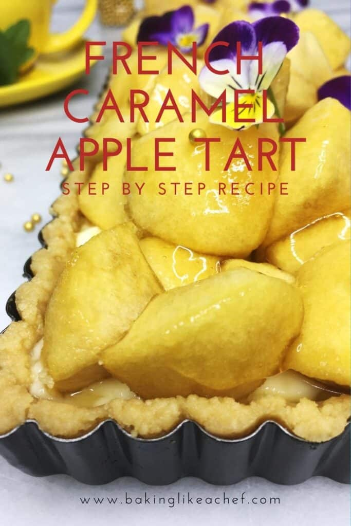 Apple tart decorated with gold pearls and flours in a tart pan with a yellow cup on the background: Pin with text