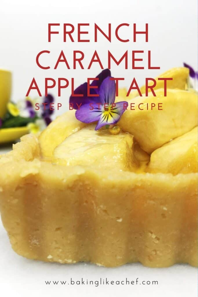 Tart loaded with caramelized apples and decorated with flours with a cup on the background: Pin with text