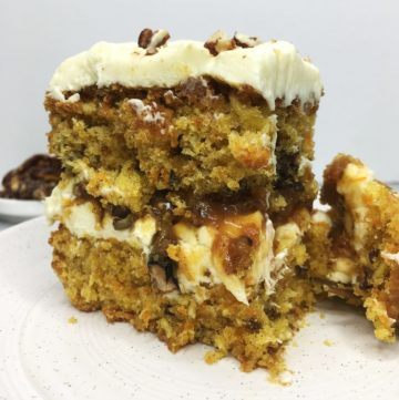 Sliced carrot cake with pecans and caramel between the cake layers: Close up