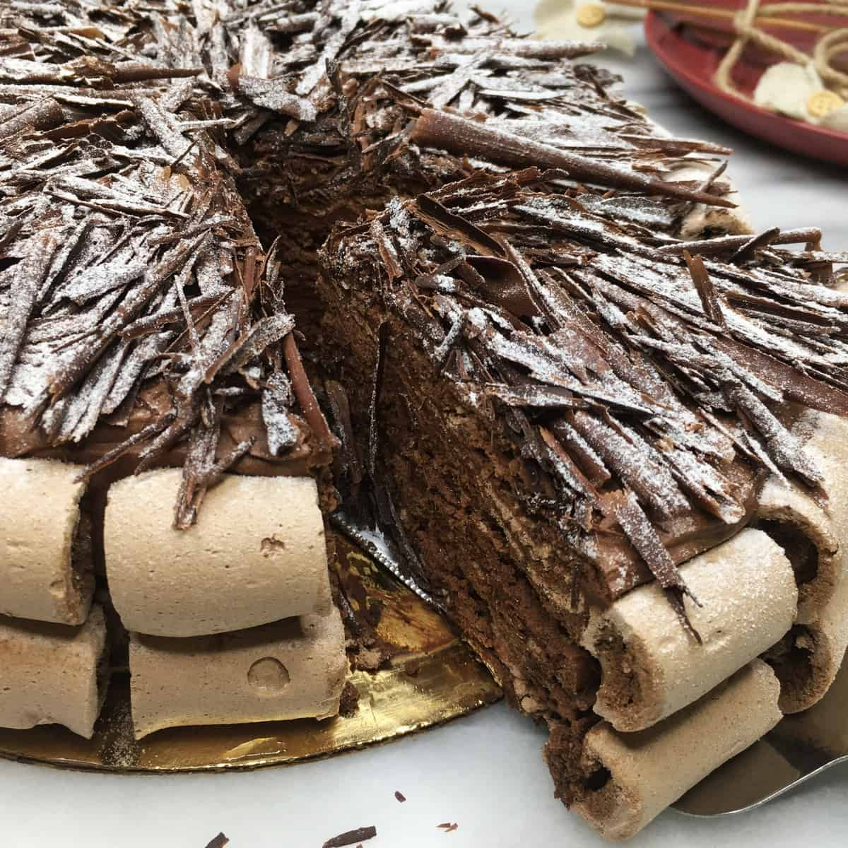 Sliced chocolate meringue cake Concorde on a cake board
