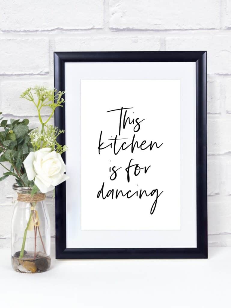Frame with text: This kitchen is for dancing