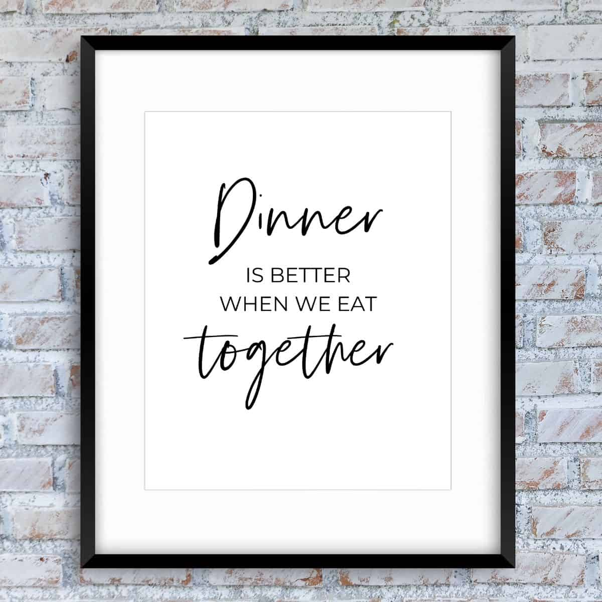Black frame on the brick wall with the text: Dinner is better when we eat together