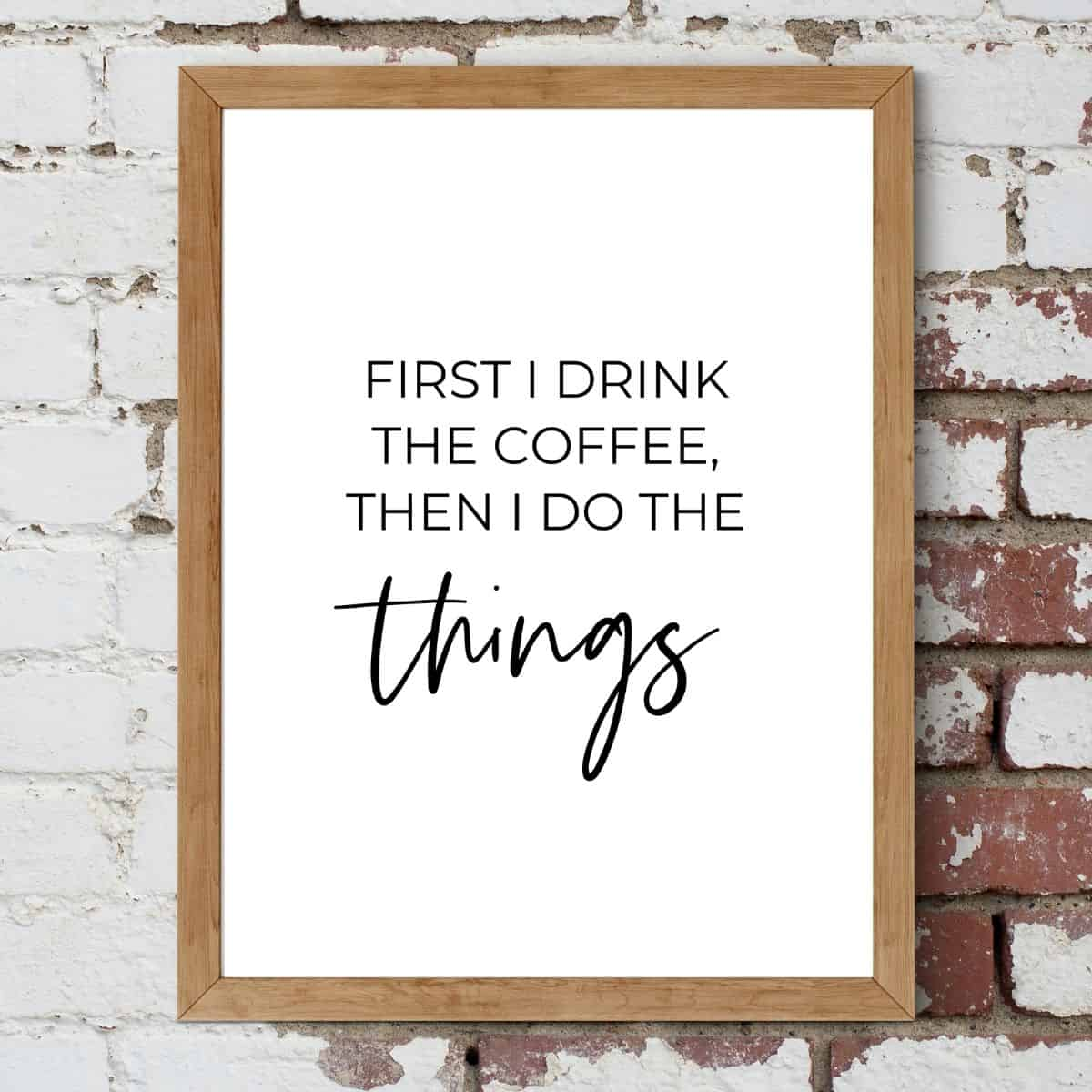 Brown frame on the brick wall with the text: First I drink the coffee, then I do the things