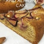 Fig and Almond cake with a slice on parchment paper with figs and almonds on background
