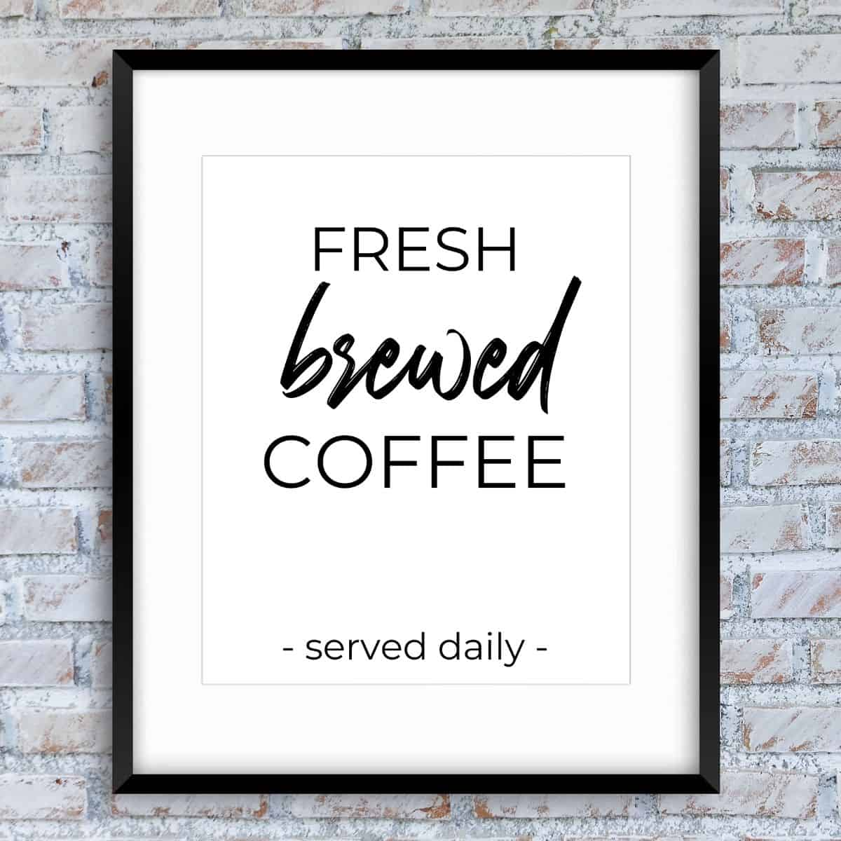 Black frame on the brick wall with the text: Fresh brewed coffee served daily