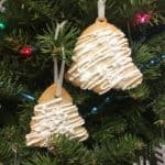 Two Gingerbread Cookie Ornaments tied to a Christmas tree: Closeup