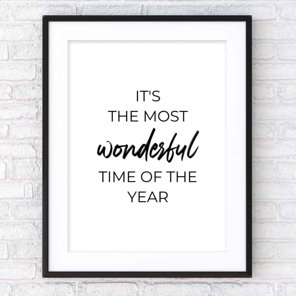 Black frame on the wall with the text: It's the most wonderful time of the year