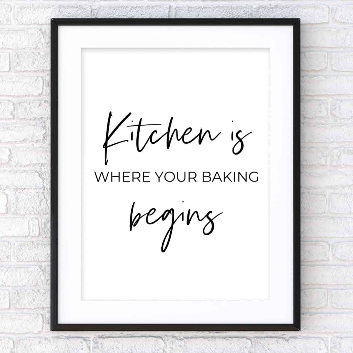 Black frame on the brick wall with the text: Kitchen is where your baking begins