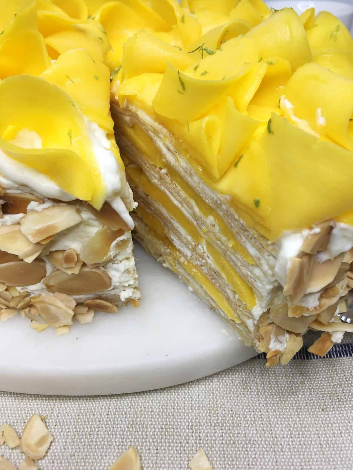 Sliced mango cake served on a marble board: Close up