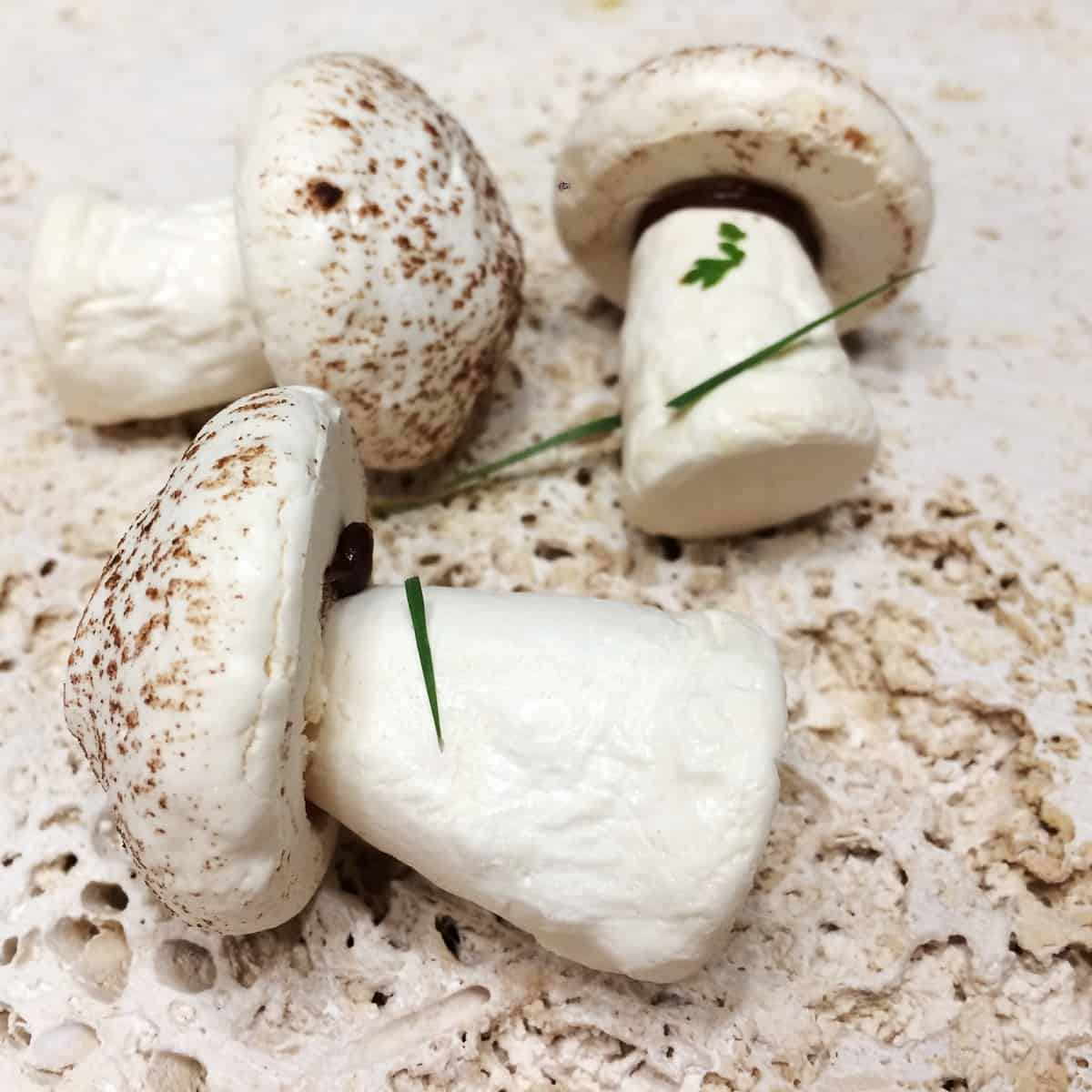 Meringue mushrooms on a stone board: Close up