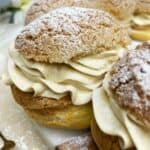 Paris-Brest dessert filled with praline mousseline cream and dusted with icing sugar: Close up