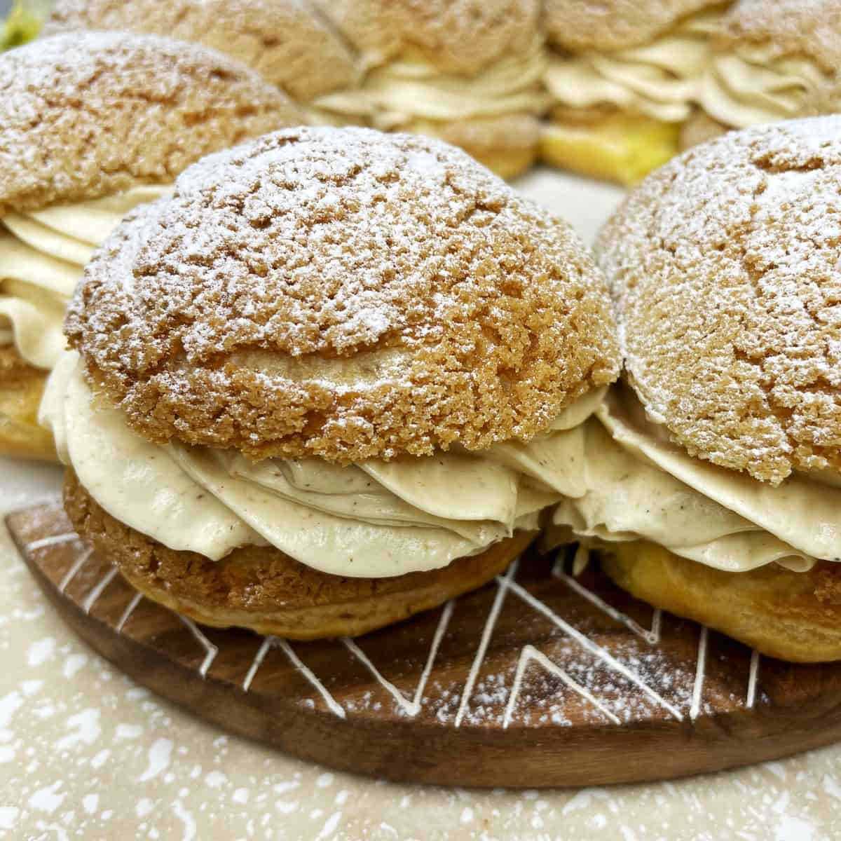 Assembled Paris-Brest dessert on a wooden and marble board
