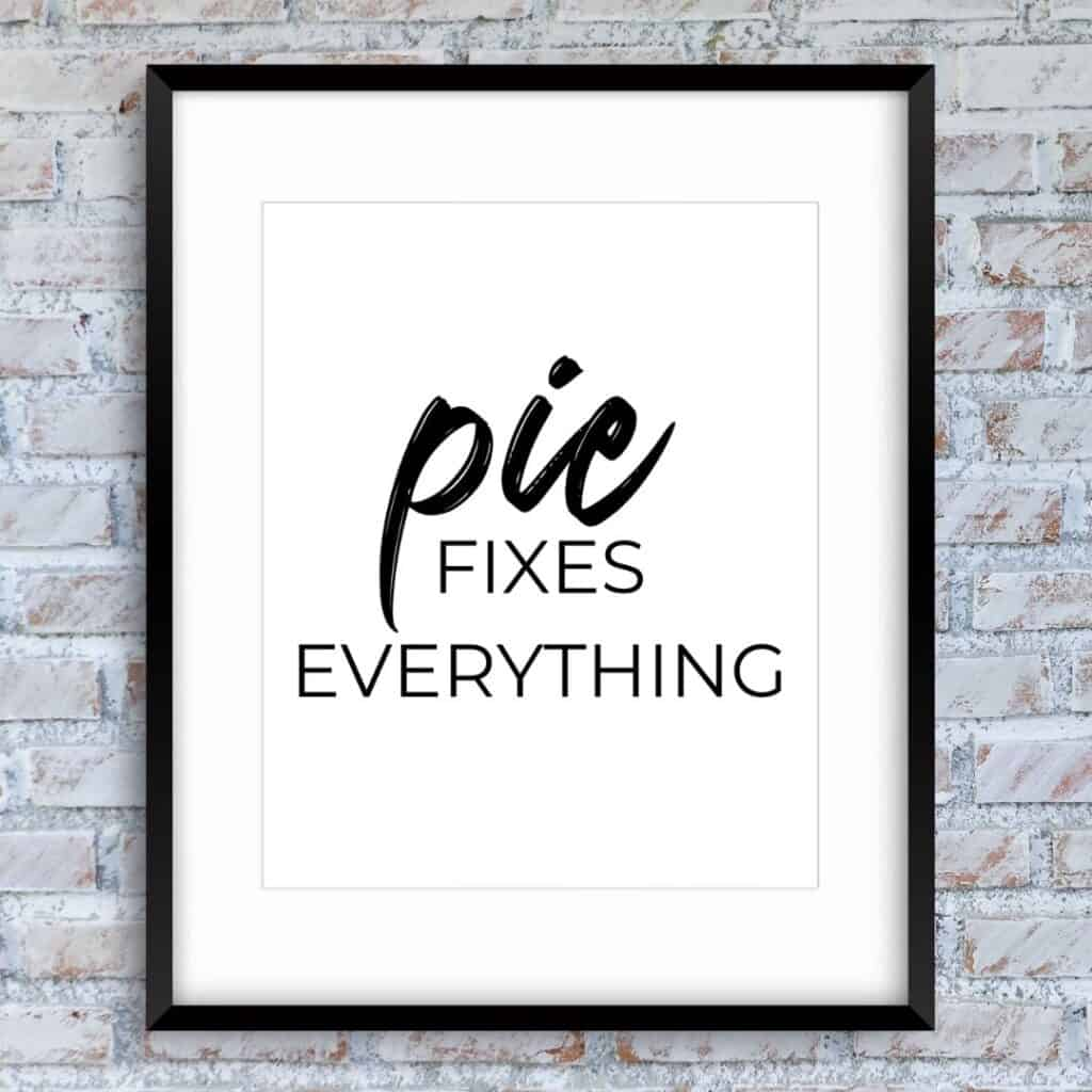 Black frame on the brick wall with the text: Pie fixes everything