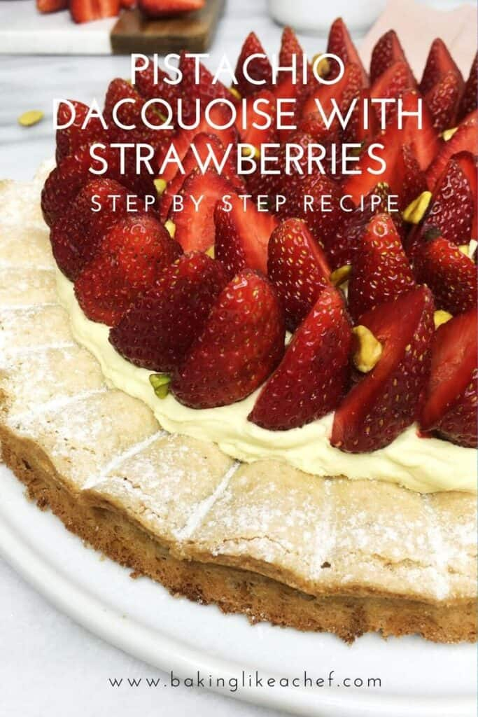 Pistachio dacquoise cake topped with cream and strawberries on a white plate: Pin with text
