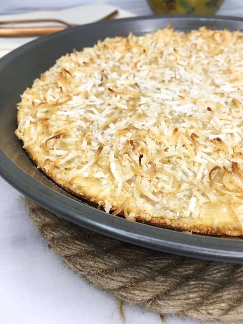 Banana cake with sprinkled coconut in a pie pan