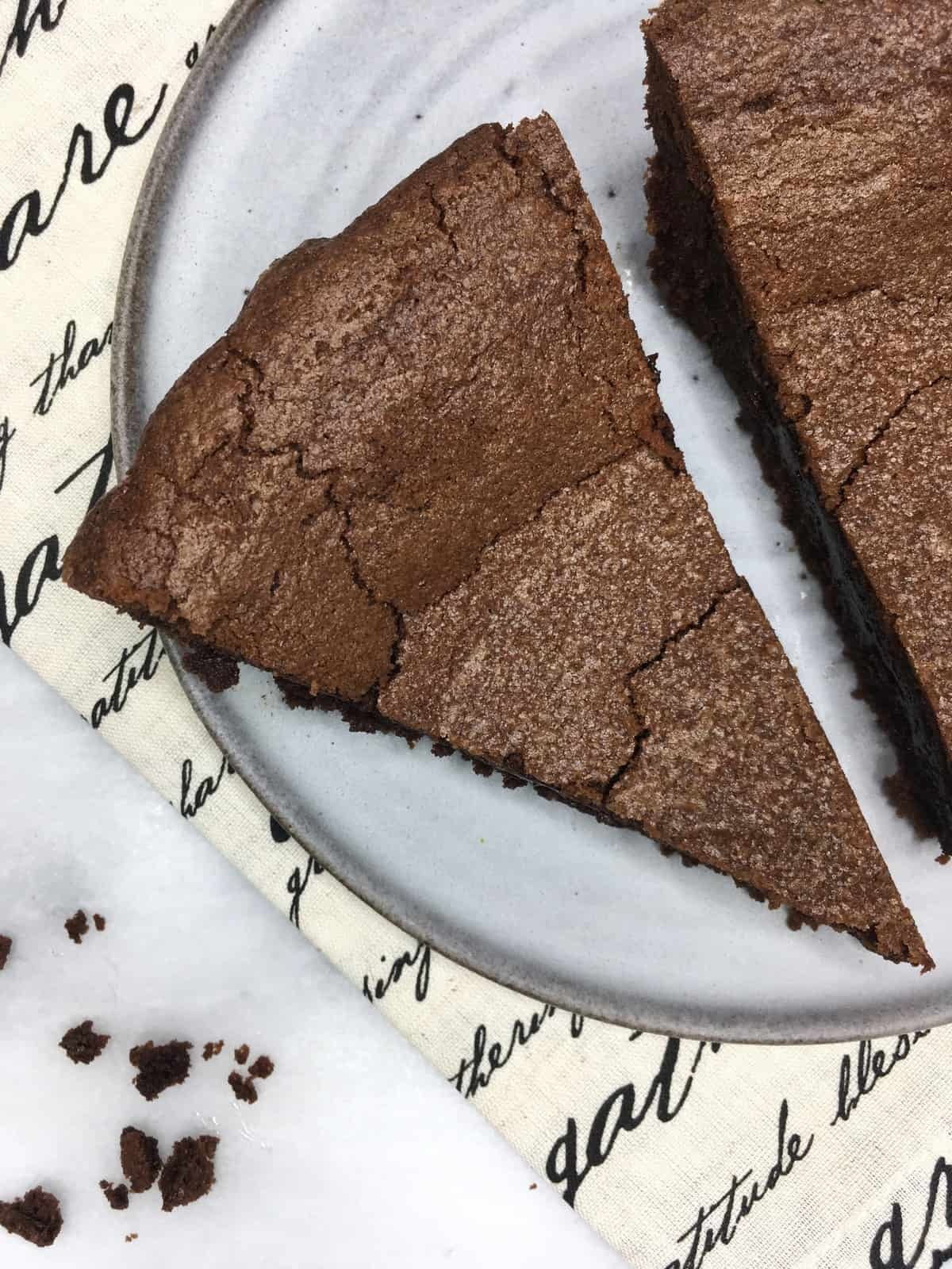Two slices of French chocolate cake on a grey plate: Overhead view